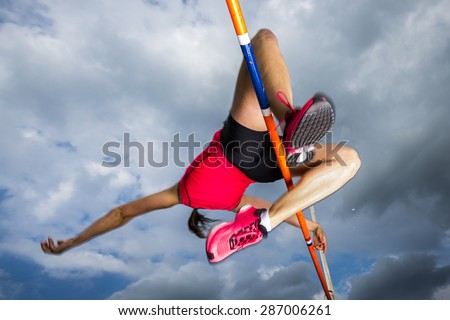 female athlete in high jump in track and field - stock photo