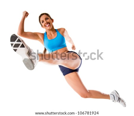 Female athlete jumping - isolated over a white background