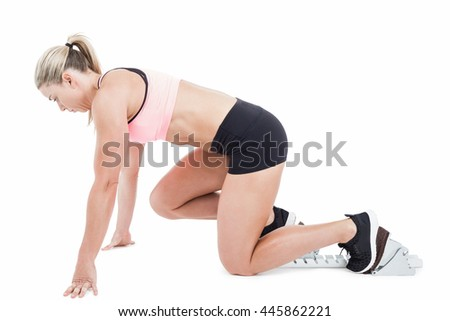 Female athlete on the start line on white background