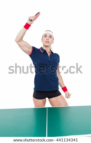 Female athlete playing ping pong on white background