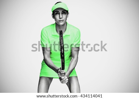 Female athlete playing tennis against white background with vignette