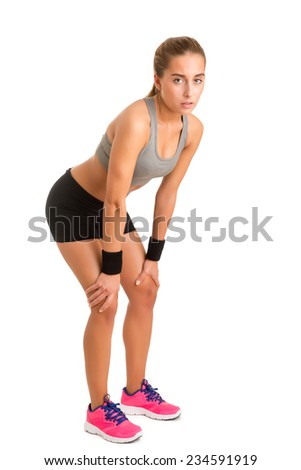 Female athlete resting after a long work out isolated in white - stock photo