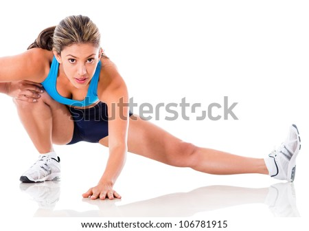 Female athlete stretching - isolated over a white background - stock photo