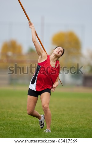 Female athlete throwing a javelin at a sports event - stock photo