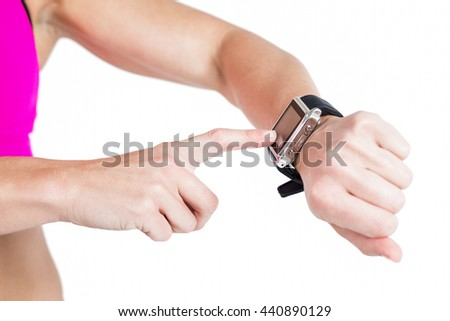 Female athlete using her smart watch on white background