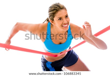 Female athlete winning the competition - isolated over a white background - stock photo
