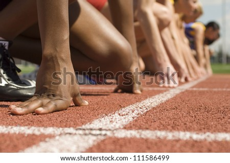 Female athletes at starting line - stock photo