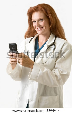 Female attractive red hair doctor wearing white lab coat holding a pager with a smile on her face