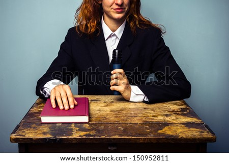 Female author at her book signing - stock photo