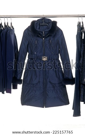 female autumn/winter clothing on hangers   - stock photo