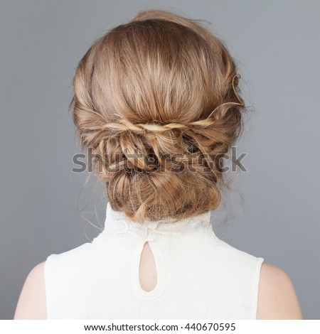 Female Back. Bridal or Prom Hairstyle - stock photo