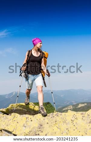 Female backpacker in hike - stock photo