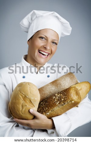 female baker with hands full of bread - stock photo