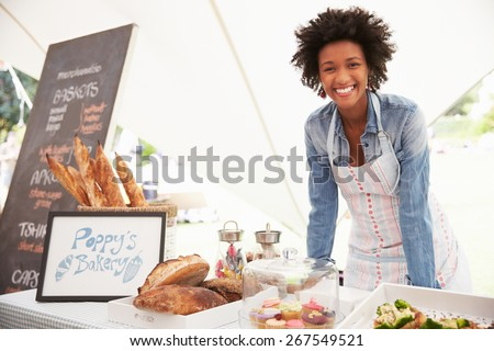 Female Bakery Stall Holder At Farmers Fresh Food Market - stock photo