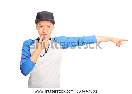 Female baseball referee blowing a whistle and pointing with her hand to the right isolated on white background - stock photo