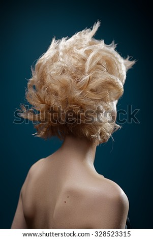 Female beauty concept. Portrait of fashionable young woman with stylish haircut wearing trendy. - stock photo
