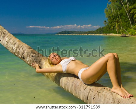 Female Beauty Exotic Hideaway  - stock photo