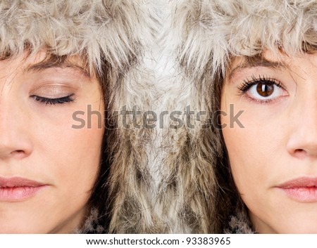 Female beauty faces of the same model - half portrait with open and with close eye in one image. - stock photo