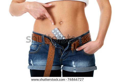 female belly with contraception pills, point with her finger to the pack of pills, isolated on white background