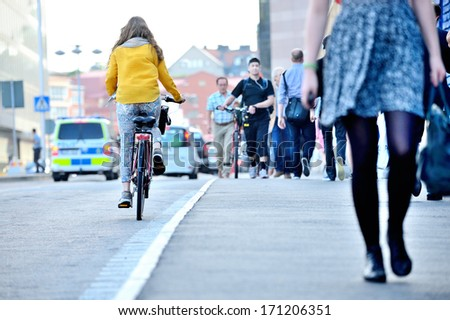 Female bicyclist on her way home - stock photo