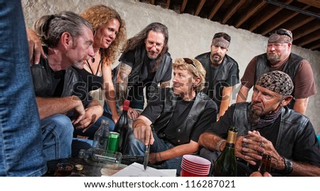 Female biker gang leader discusses plans with members