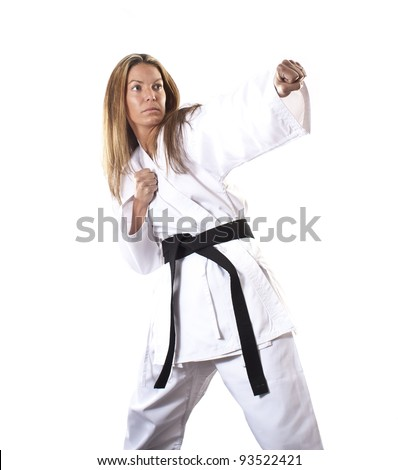Female black belt karate punch - stock photo