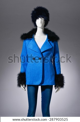 female blue cost clothing in jeans with hat on mannequin on light background - stock photo
