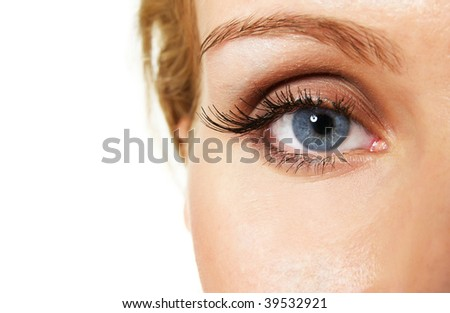 female blue eye with glittering makeup and false lashes; closeup - stock photo