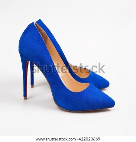 Female blue high-heeled shoes - stock photo