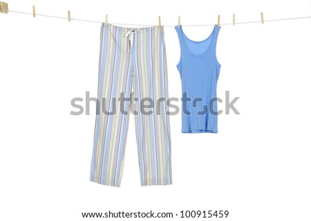 Female blue shirt and trousers clothespins on rope - stock photo
