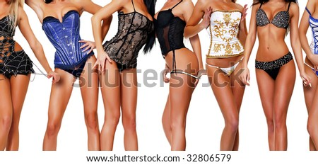 female bodies in corsets, isolated on a white background, please see some of my other parts of a body images - stock photo