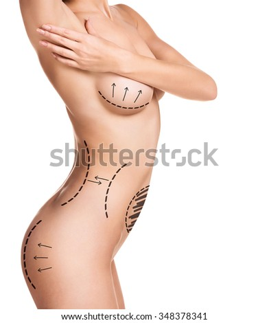 Female body with the drawing arrows on it isolated on white.  - stock photo