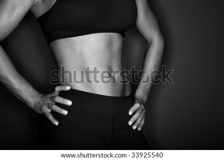 Female bodybuilder profile - stock photo