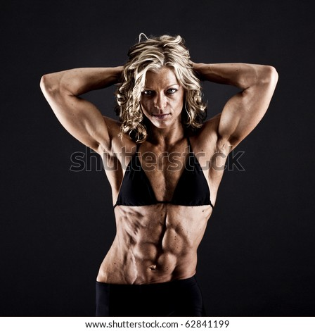 Female bodybuilder with solid defined abs - stock photo