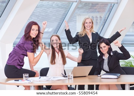 female boss and her workers are excited of their results