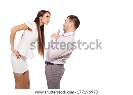 Female boss berates his subordinates. Interaction in the business team. Woman director and a man slave. The working relationship between a man and a woman. Woman dominates man at work. Isolated white. - stock photo