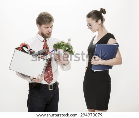 Female boss dismissing an employee. Dejected fired office worker carrying a box full of belongings, isolated on white - stock photo