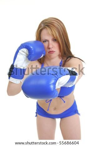 Female boxer isolated on white, focus on glove. - stock photo