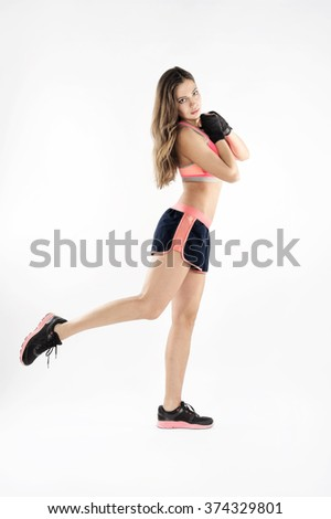 female boxer stretch and warm up for training - stock photo