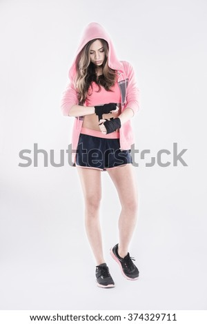 female boxer wrapping her boxer`s wraps getting ready for training  - stock photo