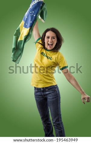 Female brazilian fan celebrating on a green background.