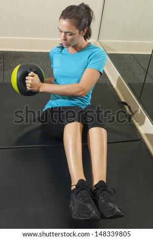 female brunette doing fitness exercise - stock photo
