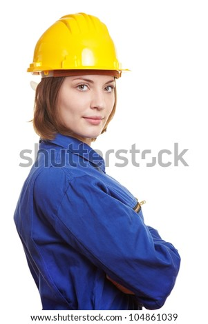Female builder with blue boiler suit and yellow safety hardhat - stock photo