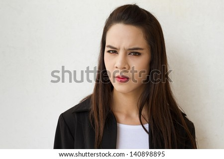 female business executive face expression with stress, anger, irritation, frustration or negative feeling - stock photo