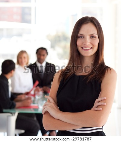 Female business leader in foreground of a meeting