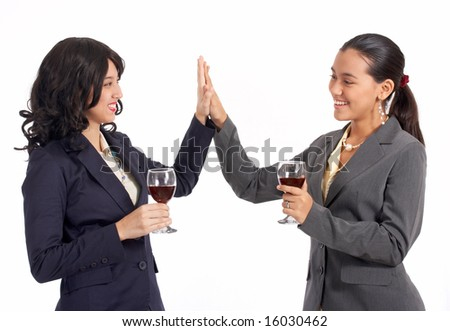 female business partners doing a high five gesture - stock photo