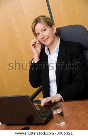 female business person with a laptop on the phone