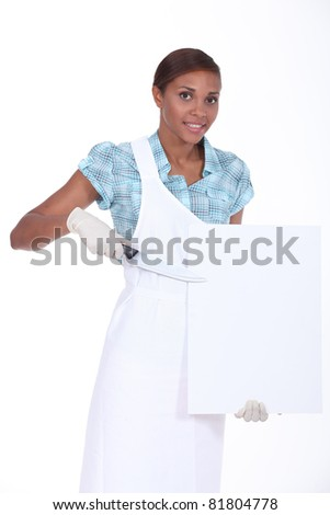 female butcher holding a blank poster - stock photo