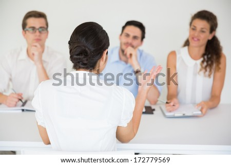 Female candidate having an interview in office - stock photo
