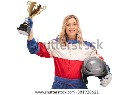 Female car racing champion holding a trophy and looking at the camera isolated on white background